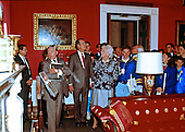 United States President George H.W. Bush and first lady Barbara Bush conduct a visitors tour in the Red Room of the White House in Washington, D.C. during his first full day as President on January 21, 1989.<br /> Credit: Dennis Brack / Pool via CNP