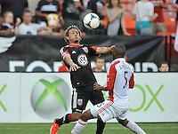 Nick De Leon (18) of D.C. United goes against Ashtone Morgan (5) of Toronto FC. Toronto FC tied D.C. United 1-1, at RFK Stadium, Saturday August 24 , 2013.