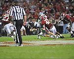 Ole Miss quarterback Bo Wallace (14) is tackled by Alabama linebacker Adrian Hubbard (42) at Bryant-Denny Stadium in Tuscaloosa, Ala. on Saturday, September 29, 2012. Alabama won 33-14. Ole Miss falls to 3-2.