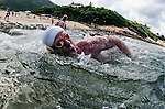 Competitors in action during the Shek O Challenge between Big Wave Beach and Shek O on July 12 2014 in Hong Kong, China. Photo by Xaume Olleros / Power Sport Images