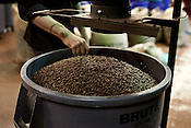 December 20, 2011. Durham, NC.. After roasting, beans are placed in barrels to await blending, and or, bagging for sale.. With the rising price of coffee worldwide and new fair trade regulations making it more difficult to get ethically traded coffee, how does local roaster Counter Culture maintain their mission and ethics?.