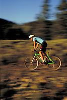 A man mountain biking, Summit County, CO. Summit County, Colorado.