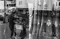 Traditional Indian clothing in the windows of a shop in Jackson Heights, Queens, New York