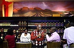 SOWETO, SOUTH AFRICA SEPTEMBER 2: Up-market people drink in a bar during a yearly Vine and Brandy festival on September 2, 2006 in Soweto, Johannesburg, South Africa. Many of the country?s vine makers came to Soweto to introduce the newly economically empowered people about vine. Traditionally, most people drink beer and whiskey and the vine makers are targeting a new black elite that have money to spend. Soweto is South Africa?s largest township and it was founded about one hundred years to make housing available for black people south west of downtown Johannesburg. The estimated population is between 2-3 million. Many key events during the Apartheid struggle unfolded here, and the most known is the student uprisings in June 1976, where thousands of students took to the streets to protest after being forced to study the Afrikaans language at school. Soweto today is a mix of old housing and newly constructed townhouses. A new hungry black middle-class is growing steadily. Many residents work in Johannesburg but the last years many shopping malls have been built, and people are starting to spend their money in Soweto.  .(Photo by Per-Anders Pettersson/Getty Images)..