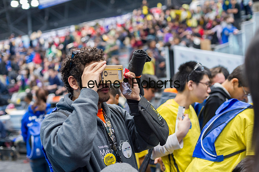 A participant tries out a Google cardboard virtual reality device at a Career Expo held at the FIRST Robotics NYC Championship at the Jacob Javits Convention Center in New York on Sunday, March 13, 2016. The expo enables participants to speak with companies and professional organizations giving a real-world look into science and technology as used in the business world and their career opportunities. (© Richard B. Levine)