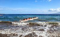 Local canoe club teams paddle outrigger canoes off of Hanakao'o Beach Park (or Canoe Beach), Lahaina, Maui.