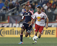 New York Red Bulls defender Heath Pearce (3) controls the ball as New England Revolution substitute forward Jerry Bengtson (27) pressures. In a Major League Soccer (MLS) match, the New England Revolution (blue) tied New York Red Bulls (white), 1-1, at Gillette Stadium on May 11, 2013.