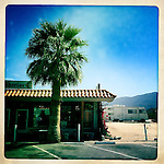 Taco shop and a mobile phone, Borrego Springs, California, USA.  There is an unique mix of Mediterranean, North African and neon American culture to the California Desert.