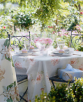 Afternoon tea laid for four on a pretty table in the garden