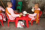 Young Monks Eating Near Gyee Zai Market
