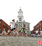 Litchfield, CT-13, June 2010-061310CM08 11 and 12 years start their 2.3 mile race through downtown Litchfield Sunday afternoon.  The kids fun race was held minutes before the 34th annual Litchfield Hills Road Race took off.  --Christopher Massa Republican-American