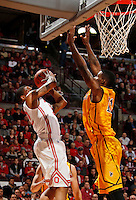 Ohio State Buckeyes guard Lenzelle Smith Jr. (32) maneuvers under the basket around Wyoming Cowboys forward Derek Cooke Jr. (11) during the first half of the NCAA basketball game at Value City Arena in Columbus on Nov. 25, 2013. (Adam Cairns / The Columbus Dispatch)