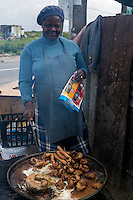 South Africa, Cape Town, Guguletu Township.  Street Food Vendor Cooking Sausages.