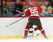 Ryan Grimshaw (Harvard - 6), Mark Armstrong (St. Lawrence - 95) - The Harvard University Crimson defeated the St. Lawrence University Saints 4-3 on senior night Saturday, February 26, 2011, at Bright Hockey Center in Cambridge, Massachusetts.