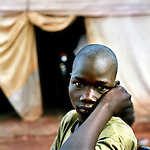 Children in Save the children supported  Gusco rehabilitation centre in Gulu, North Uganda. ..Peter, 14. Spend nearly 2 years with the LRA. Peter was hit in the leg by shrapnel form a governemnent helicopter gunship and the rebels abandoned him. But he returned to bad news, and an uncertain future. 'My father has died while I was away, my family wont tell me how, he used to pay for my schooling and to teach me how to care for the land. Now there is only my stepmother, but she is old she cant care for me, I will have to care for her'...DO NOT USE WITHOUT PERMISION.