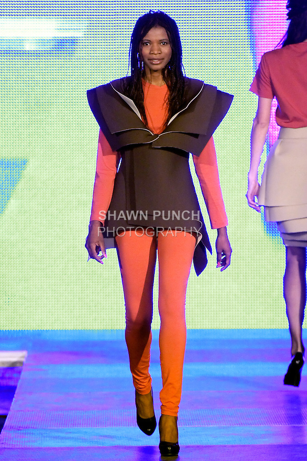Model walks runway in an outfit from the High School of Art Design 2011 &quot;Futurama&quot; collection, during the Factory Fashion Show 2012, organized by Ina Budovksa in Trencin Slovakia, May 3, 2012.