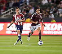 Chivas USA defender Jimmy Conrad (12) moves the ball up the field past Colorado Rapids forward Caleb Folan (21) the ball during the first half of the game between Chivas USA and Colorado Rapids at the Home Depot Center in Carson, CA, on March 26, 2011. Final score Chivas USA 0, Colorado Rapids 1.