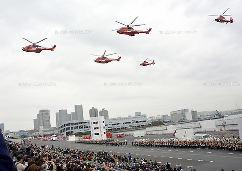 January 6, 2016, Tokyo, Japan - Firefighters demonstrate their firefighting and rescue techniques during an annual New Year's review of the Tokyo Fire Department on Wednesday, January 6, 2016. A fleet of 140 fire engines and fireboats, and 2,700 people participated in the annual drill on the water front. (Photo by Natsuki Sakai/AFLO)