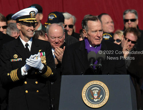 Norfolk, VA - January 10, 2009 -- Former President George H.W. Bush receives a standing ovation before delivering his keynote address at the commissioning ceremony for the aircraft carrier USS George H.W. Bush (CVN 77) at Naval Station Norfolk, Va. Bush delivered the keynote address at the commissioning. The Navy's newest, and final, Nimitz-class aircraft carrier is named after the World War II naval aviator and 41st president of the United States..Credit: Micah P. Blechner - U.S. Navy via CNP