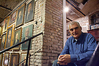 Gallery owner Peter Pinter talks about paintings made in the style of socialist realism and sculptures depicting late Soviet leader Vladimir Ilyich Lenin. Large number of artifacts from Hungary's socialist past was found in the basements of different ministries after a change in political power. These communist pictures and sculptures are now being prepared for a charity auction to support those affected by the recent red sludge catastrophe in Hungary. The auction drawing great attention from around the world is to be held on December 6th in Budapest, Hungary. Photos taken during preparations for the auction on November 25, 2010. ATTILA VOLGYI