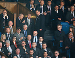 Celtic secuity chief Ronnie Hawthorn has words with Rangers staff in the directors box at the start of the second half after manager Neil Lennon was told to sit in the stand by ref Calum Murray