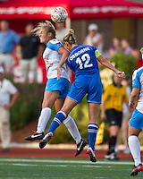 Chicago Red Stars defender Lauren Fowlkes (9) and Boston Breakers midfielder Leslie Osborne (12) jump for a high ball.  The Boston Breakers beat the Chicago Red Stars 1-0 at Dilboy Stadium.
