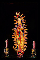 A carving, or bulto, of the Virgin of Guadalupe donated by deveotees to the church in Ojo Caliente, New Mexico. Cover image for the book Viva Guadalupe
