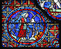 A warmly dressed vineyard worker pruning the bare vines with a sickle at the end of winter, section of March from the Zodiac and the labours of the months stained glass window, 1217, in the ambulatory of Chartres Cathedral, Eure-et-Loir, France. This calendar window contains scenes showing the zodiacal symbol with its corresponding monthly activity. Chartres cathedral was built 1194-1250 and is a fine example of Gothic architecture. Most of its windows date from 1205-40 although a few earlier 12th century examples are also intact. It was declared a UNESCO World Heritage Site in 1979. Picture by Manuel Cohen