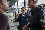 An Afghan couple listen to other refugees. <br /> <br /> Hundreds of refugees from mostly Syria and Afghanistan gather at the Budapest Keleti railway station waiting for trains to leave for destinations such as Austria, Germany and Sweden, in Budapest, Hungary, on Tuesday, Sept. 8, 2015. Hungary's Prime Minister Viktor Orban created an anti-refugee campaign to generate hate against those fleeing war in their home countries. The country is currently 50% xenophobic and the government has become increasingly authoritarian.