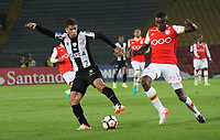 BOGOTA -COLOMBIA, 19-04-2017.    Vitor Bueno (L)<br /> player of   Santos of Brazil fights the ball agaisnt of  Hector Urrego (R) player of  Independiente Santa Fe of Colombia during match for the date 3   for the Conmebol Libertadores Bridgestone Cup 2017 played at Nemesio Camacho El Campin stadium . Photo:VizzorImage / Felipe Caicedo  / Staff