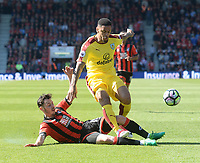 Bournemouth's Adam Smith slides in on Burnley's Andre Gray<br /> <br /> Photographer Ian Cook/CameraSport<br /> <br /> The Premier League - Bournemouth v Burnley - Saturday 13th May 2017 - Vitality Stadium - Bournemouth<br /> <br /> World Copyright &copy; 2017 CameraSport. All rights reserved. 43 Linden Ave. Countesthorpe. Leicester. England. LE8 5PG - Tel: +44 (0) 116 277 4147 - admin@camerasport.com - www.camerasport.com