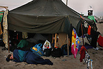 3 days before Israel's pullout from Gaza, a young woman sleeps early morning outside her tent, at the outpost of Shirat Hayam, in the Israeli settlement bloc of Gush Katif, Gaza Strip. Hundreds of Israelis have settled in improvised compounds in Gush Katif, in order to help the settlers resist the Disengagement.