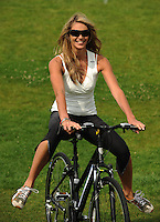 Elle MacPherson, launches Sky's campaign to get people back on their bikes, through a summer of free Skyride cycling events. Regents Park. London.