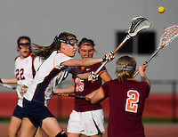 Anne Thomas (21) of Virginia takes a shot during the first round of the ACC Women's Lacrosse Championship in College Park, MD.  Virginia defeated Virginia Tech, 18-6.