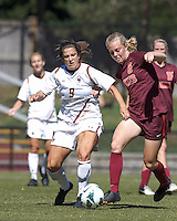 Boston College forward Stephanie McCaffrey (9) dribbles the ball as Virginia Tech midfielder Kelsey Loupee (9) defends.Virginia Tech (maroon) defeated Boston College (white), 1-0, at Newton Soccer Field, on September 22, 2013.