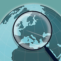 Magnifying glass above Europe on globe  ExclusiveImage