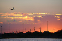 Tempe, Arizona. A northwestern view of Tempe Town Lake at sunset. The airplane seen is about to land at nearby Phoenix Sky Harbor International airport. The Photo by Eduardo Barraza © 2015