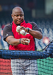 20 May 2014: Cincinnati Reds first base coach Billy Hatcher throws batting practice prior to a game against the Washington Nationals at Nationals Park in Washington, DC. The Nationals defeated the Reds 9-4 to take the second game of their 3-game series. Mandatory Credit: Ed Wolfstein Photo *** RAW (NEF) Image File Available ***