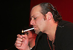 """Moenia pop music band member, Alfonso Pichardo lights a cigarrette as he talks to reporters during a press conference,in Mexico City March 28, 2006. Moenia received a golden award after selling 50 thousand copies of their last CD """"Hits Live"""". Photo by © Javier Rodriguez"""
