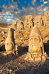 Image of the statues of around the tomb of Commagene King Antochus 1 on the top of Mount Nemrut, Turkey. Stock photos &amp; Photo art prints. In 62 BC, King Antiochus I Theos of Commagene built on the mountain top a tomb-sanctuary flanked by huge statues (8&ndash;9 m/26&ndash;30 ft high) of himself, two lions, two eagles and various Greek, Armenian, and Iranian gods. The photos show the broken statues on the  2,134&nbsp;m (7,001&nbsp;ft)  mountain. 2