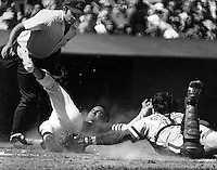 "Oakland Athletics Bert ""Campy"" Campaneris slides safe at home, Umpire is Dave Phillips.. (1976 photo by Ron Riesterer)"