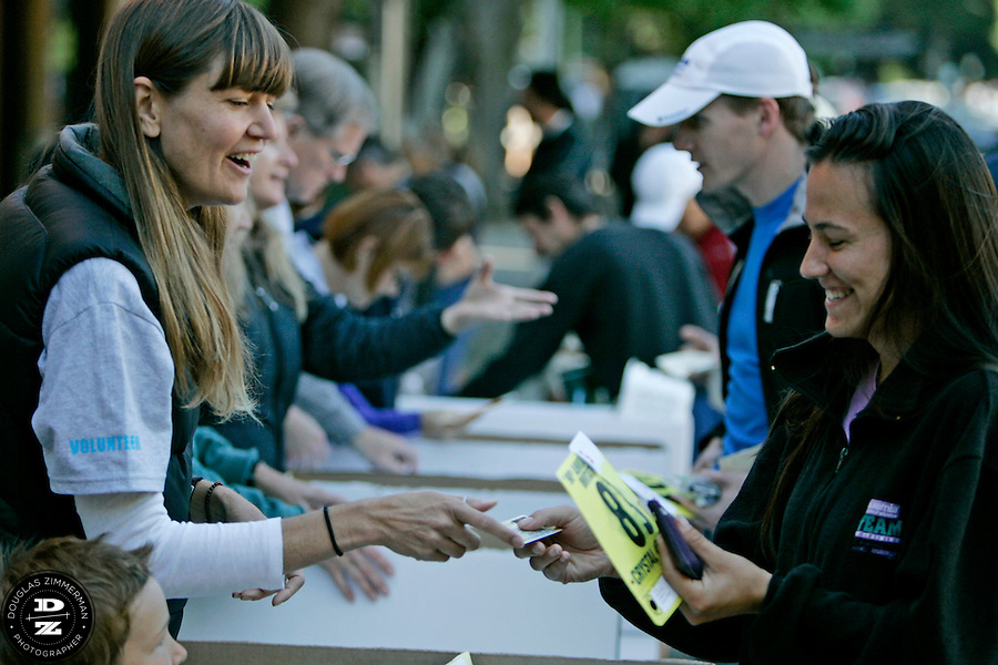 Shawn Yarnell, left, of Mill Valley Calif. helps Moriah Buckley of Novato, CA (83) find her bib in downtown Mill Valley before the 98th running of the Dipsea Race from Mill Valley, Calif. to Stinson Beach over Mt. Tamalapais.  The race  happened on Sunday, June 8, 2008.