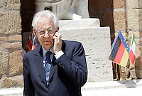 Il Presidente del Consiglio Mario Monti parla al telefonino prima dell'inizio del Vertice Quadrilaterale fra Italia, Spagna, Francia e Germania, a Villa Madama, Roma, 22 giugno 2012..Italian Premier Mario Monti uses his mobile phone prior to the beginning of the Quadrilateral Summit among Italy, Spain, France and Germany, at Villa Madama, Rome, 22 june 2012..UPDATE IMAGES PRESS/Riccardo De Luca