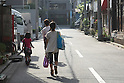 May 5, 2010 - Tokyo, Japan - A Japanese family walks in a street of Tokyo, Japan, on May 5, 2010. The number of children aged under 15 in Japan has hit a record low of under 17 million, according to a government report released Tuesday. The child population is estimated to have dropped 190,000 from a year earlier to 16.94 million, marking the 29th consecutive annual decline. The report also showed that children's share of the nation's entire population stood at 13.3%, compared with 23% for a population of people aged over 65.