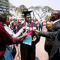 Journalists interview 70-year-old Alfonso Pedro Van-Dunnem, also known as 'Mbinda'. He is the oldest graduate from the law faculty's 2009/10 academic year. He is a member of the MPLA and was once Minister of International Affairs..
