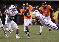 CHARLOTTESVILLE, VA- NOVEMBER 12:  Cornerback Chase Minnifield #13 of the Virginia Cavaliers runs past running back Juwan Thompson #23 and wide receiver Conner Vernon #2 of the Duke Blue Devils during the game on November 12, 2011 at Scott Stadium in Charlottesville, Virginia. Virginia defeated Duke 31-21. (Photo by Andrew Shurtleff/Getty Images) *** Local Caption *** Chase Minnifield;Conner Vernon;Juwan Thompson