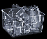 X-ray image of full recycle bin (blue on black) by Jim Wehtje, specialist in x-ray art and design images.