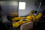 """U2 pilot Major Eric Shontz rides in a van to the flightline for a """"high-flight"""" at Beale Air Force Base February 24, 2010 in Linda, Calif."""