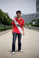 Zhangxianlong, a student, age 23, poses for a portrait in Nanjing. Response to 'What does China mean to you?': 'China is a powerful country. The people are good. The mountains are good. The water is even better.'  Response to 'What is China's role in the future?': 'A powerful economy. A geographically large country. An emissary of peace.'