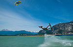 July 15th, 2009.  The Owner of Vancouver Kiteboarding School Colin Ernst, in the middle of a trick, at the Spit Squamish, BC.  Photo by Gus Curtis.